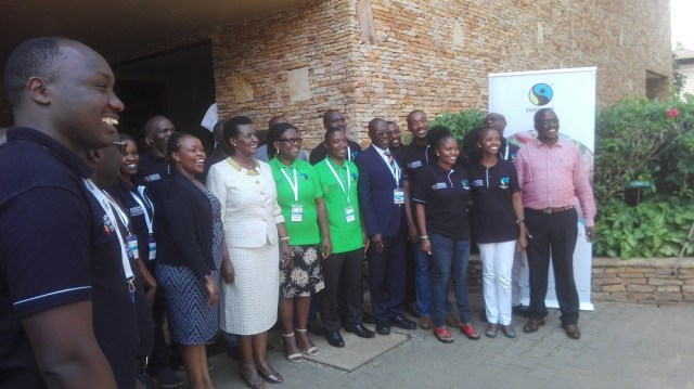 Fairtrade Africa members join Uganda's Minister of Trade, Industry and Cooperatives Amelia Kyambadde in a group photo at Speke Resort Munyonyo.
