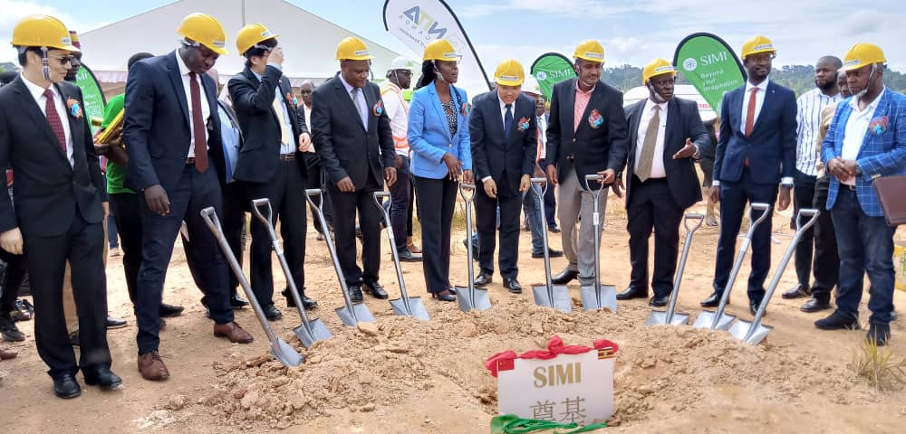 Minister Frank Tumwebaze 5th from Right with other officials at holding spades during the ground breaking for the construction of the facility