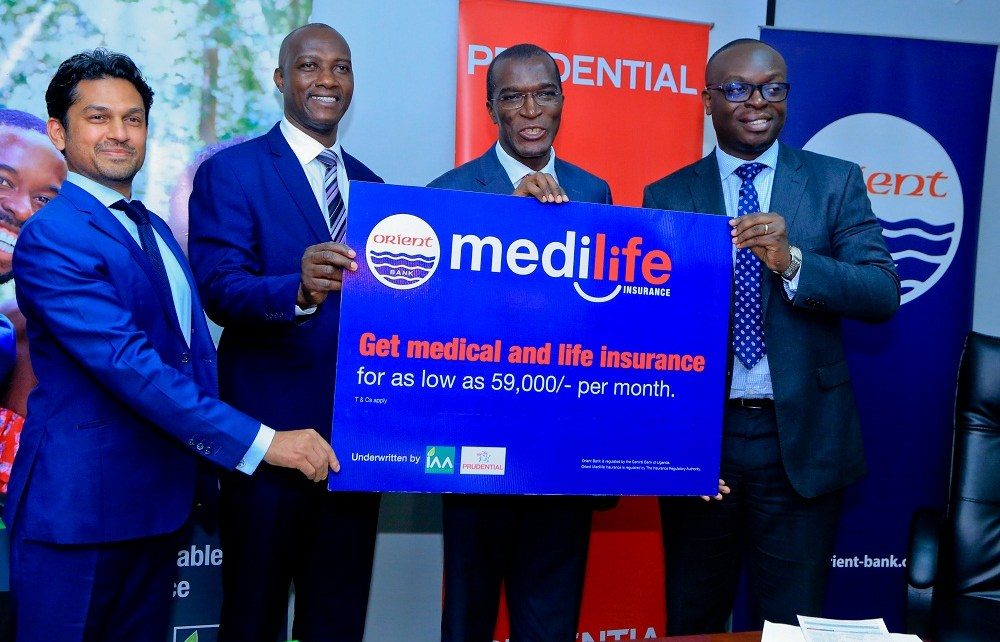 (R-L): Julius Kakeeto, MD of Orient Bank Limited together with Alhaj Kaddunabbi Ibrahim Lubega, CEO Insurance Regulatory Authority, Herbert Mukoza, General Manager IAA and Arjun Mallik, MD Prudential East Africa officially unveil medilife, a new medical and life insurance cover.