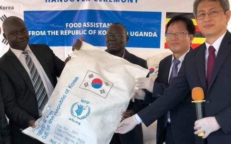 Ambassador of South Korea on Right Ha Byung-Kyoo, handing over some of the Rice sacks to the officials from the WFP