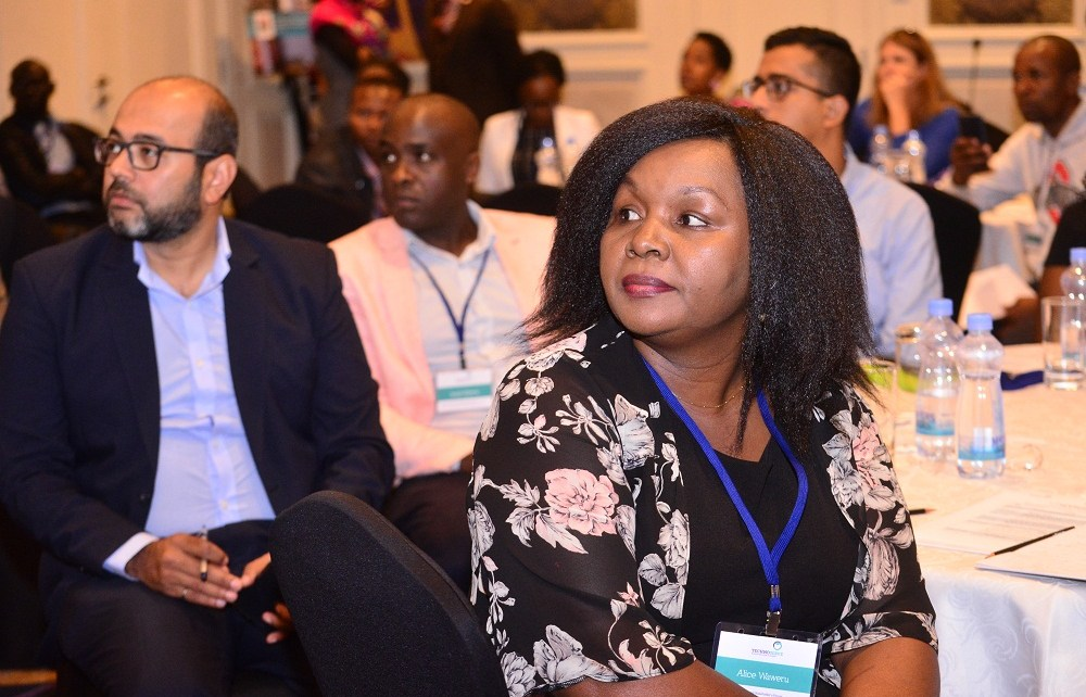 Rizwan Yusufali (L) and Alice Waweru (R) from TechnoServe follow discussions at the third Smart Duka forum. The Smart Duka program aims at boosting skills for micro-retailers.