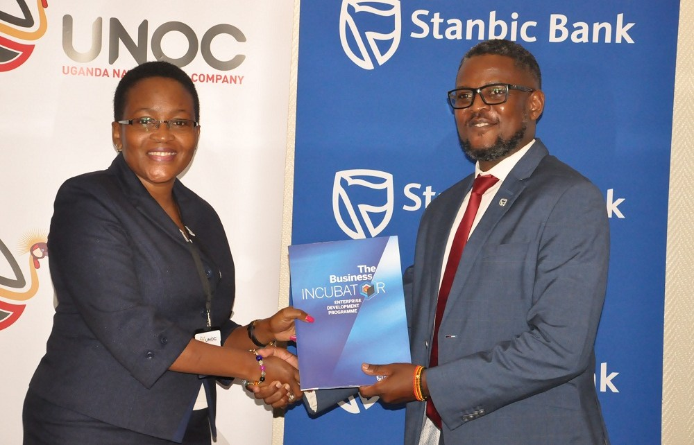 Stanbic Bank Uganda through its Business Incubator has entered into a partnership with the Uganda National Oil Company to promote national content through the capacity building through offering business training for entrepreneurs, knowledge/sector information sharing and enterprise development.