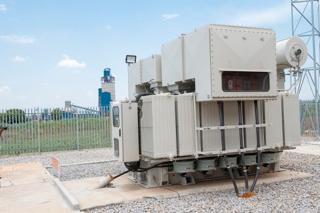 Sh14b Nyakesi transformers (left), supplying reliable electricity to Hima and Simba cement plants (right) in Tororo.jpg