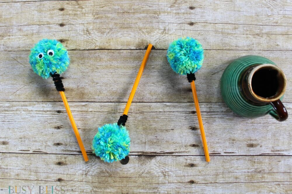 Learn how to make these fun pom pom pencils for kids! These are great if you are looking for easy craft ideas for back to school time.