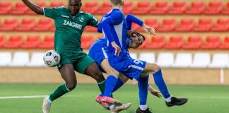 Philip Otele dribbles past two players busybuddiesng.com