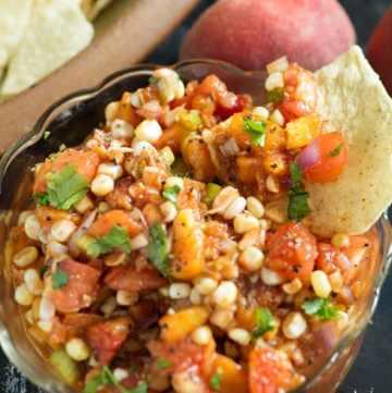 A bowl of Corn and Peach Salsa