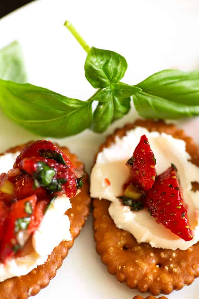 Pretzel crackers topped with cream cheese and strawberries