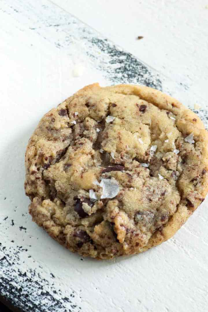 A single chocolate chip cookie with grated chocolate