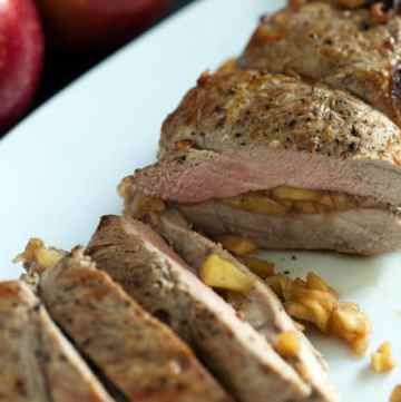 Pork tenderloin baked in the oven with caramelized apples and an orange juice glaze will melt in your mouth. Easy to assemble and make ahead. |butterandbaggage.com
