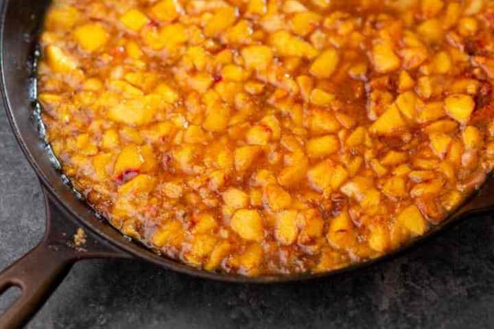 A skillet of peaches for Peach Dutch Baby Pancake