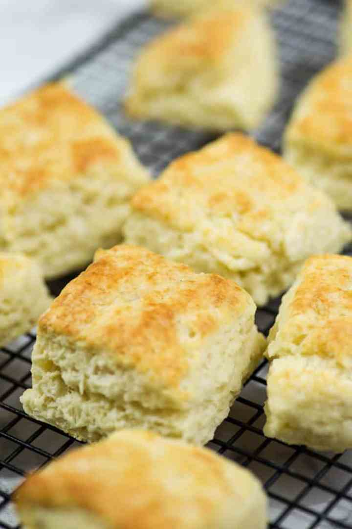 A cooling rack with square buttermilk biscuits