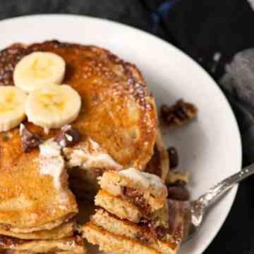 A fork full of banana bread pancakes