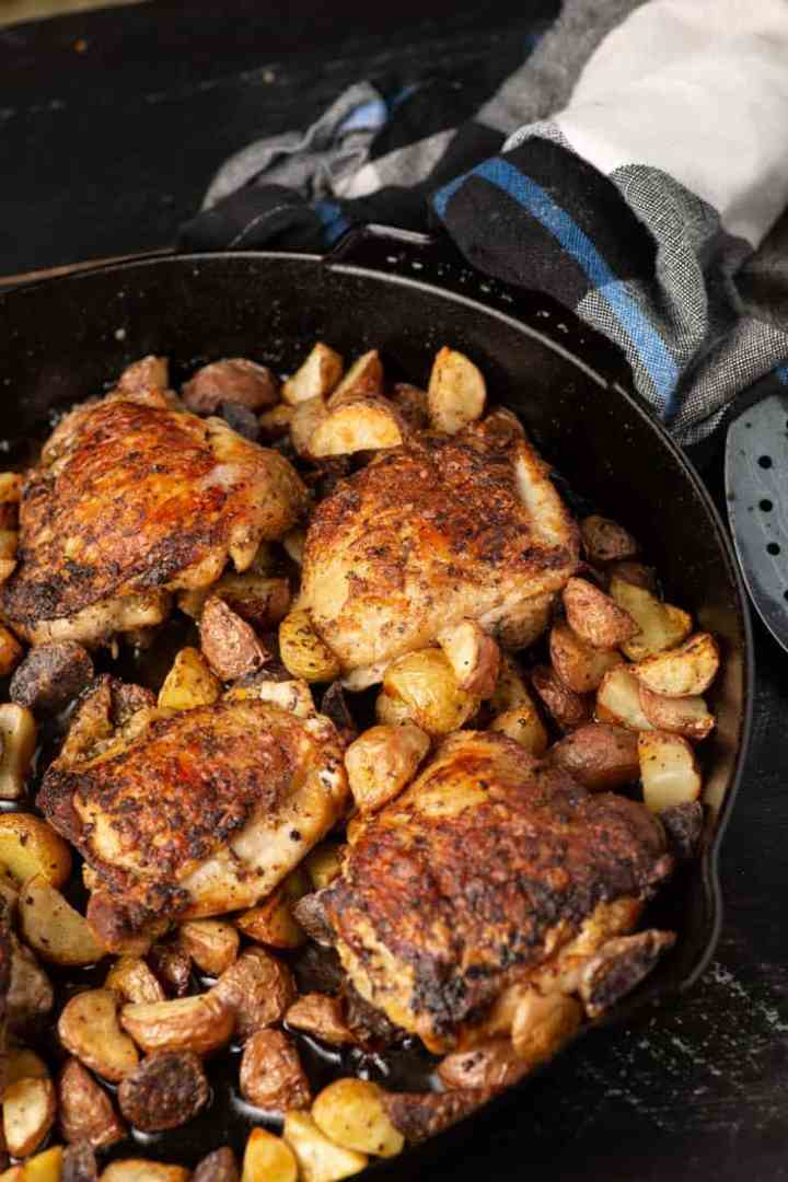 A skillet of roasted chicken with potatoes