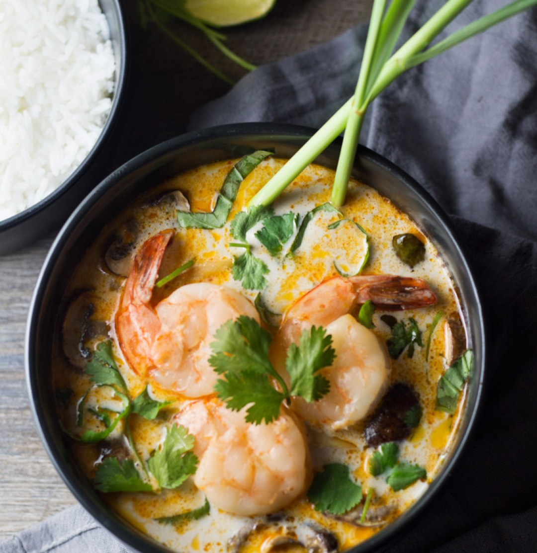 Thai Coconut Shrimp Soup - This Thai coconut soup has layers of flavors. You get pops of coconut, lemon grass, ginger, lime, red curry flavors. Absolutely delicious! | butterandthings.com