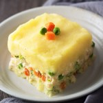 Peruvian Causa Rellena is a layered potato dish, made with potatoes and chicken salad. It is so tasty bursting with delightful flavors. | www.butterandthings.com
