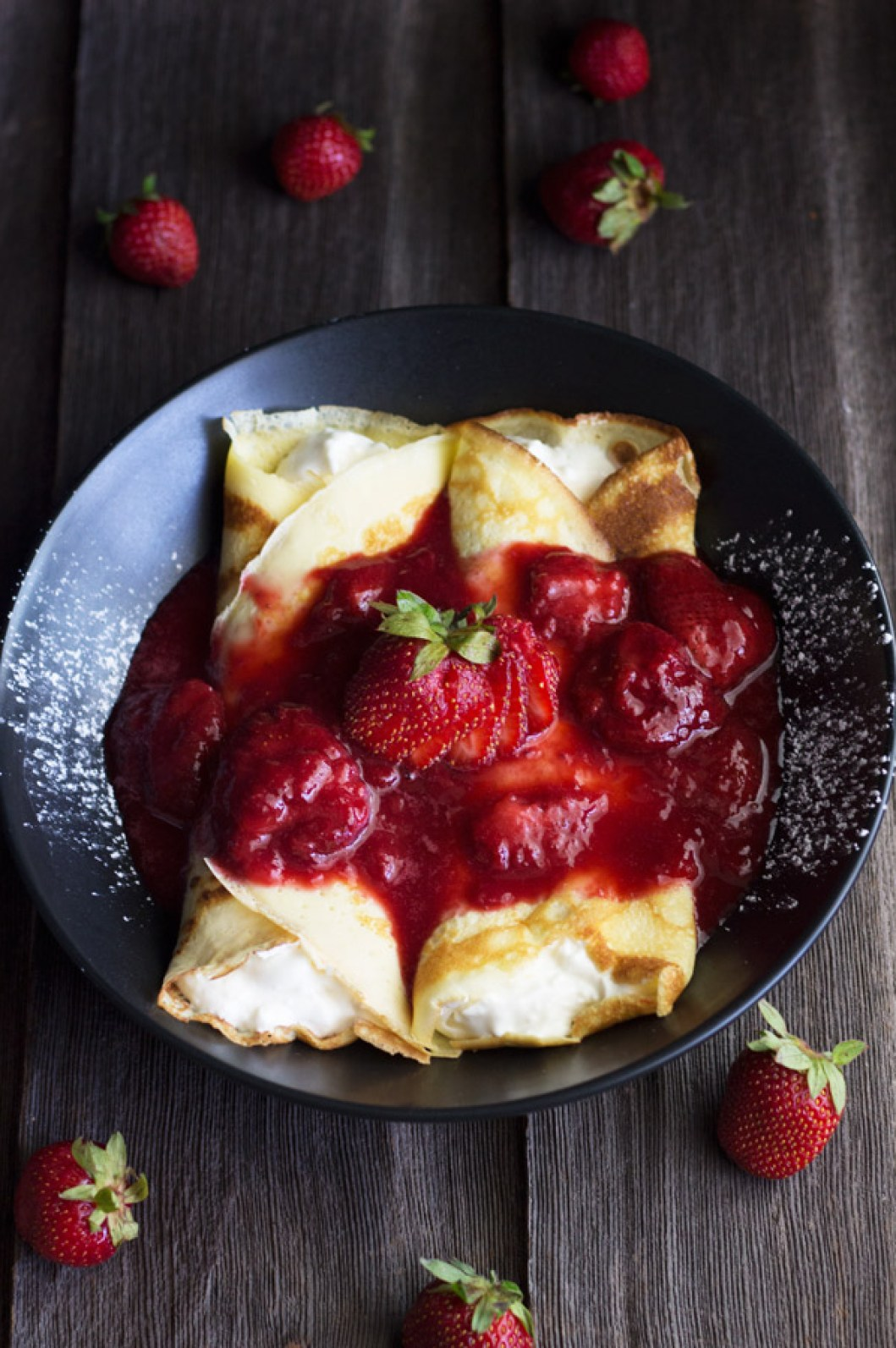 Strawberry Cream Filled Crepes are like a very thin pancake filled with cream and topped with strawberry topping. They are easy to make and yummy to eat. | www.butterandthings.com