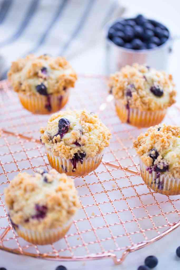 blueberry muffins on gold wire rack