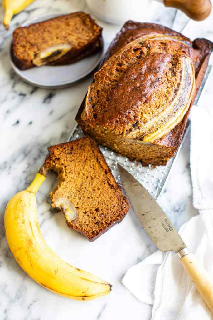 brown sugar banana bread sliced on a marble counter top