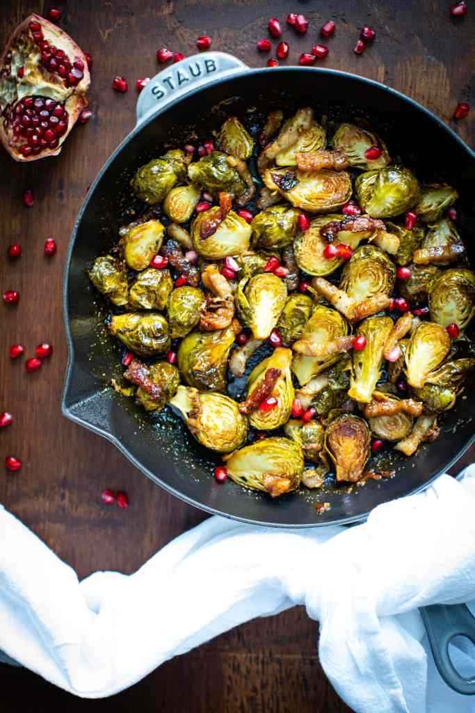 brussels sprouts in gray skillet with a white linen