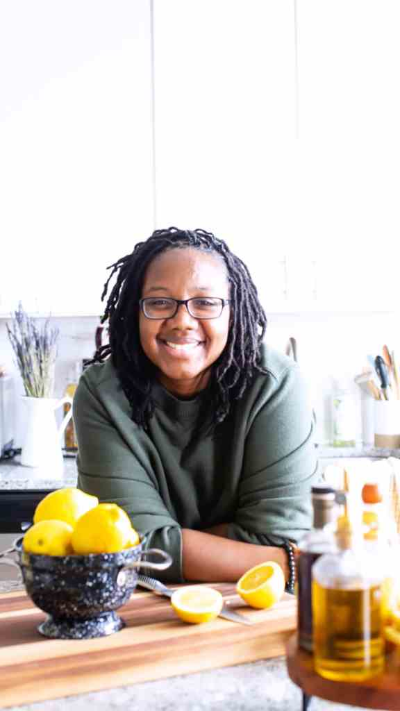 black woman smiling in white kitchen