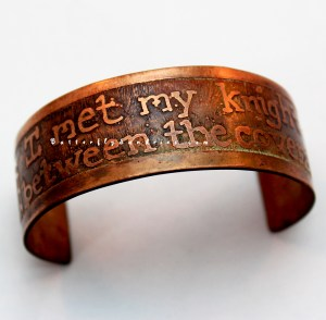 Celebrating old romance and fantasy novels with imperfect printing, this new etched cuff is a great accessory for the mischievous!