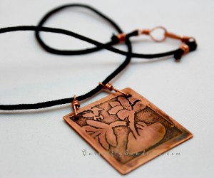 This beautiful pendant was inspired by those women who have the courage to, despite difficult circumstance, look within themselves to find their own strength and beauty... who discover their ability to embrace their power to stand up for their hopes, even in the ugliest of situations.
