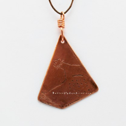 Etched Copper Bascinet Pendant Close-up Hanging on White