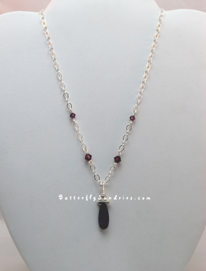 Purple Swarovski SS Necklace Hanging on White