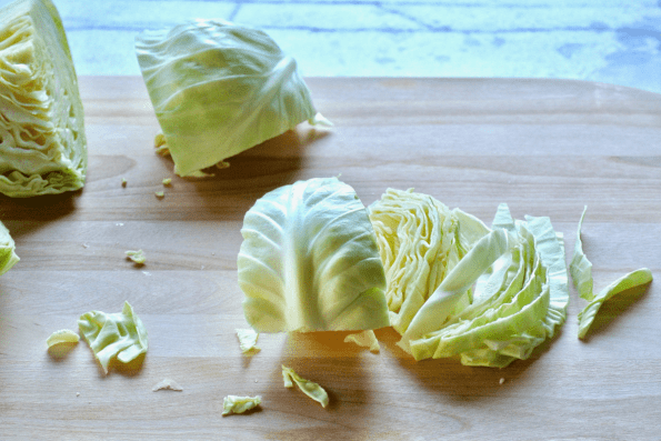 The cabbage is sliced vertically yielding long noodle like pieces.