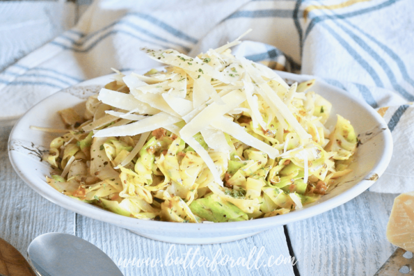 Freshly cooked garlic butter cabbage noodles are the perfect replacement for pasta. This big bowl of garlicky goodness is topped with lots of real parmesan cheese!
