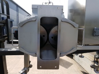 Twin auger chamber discharge flange