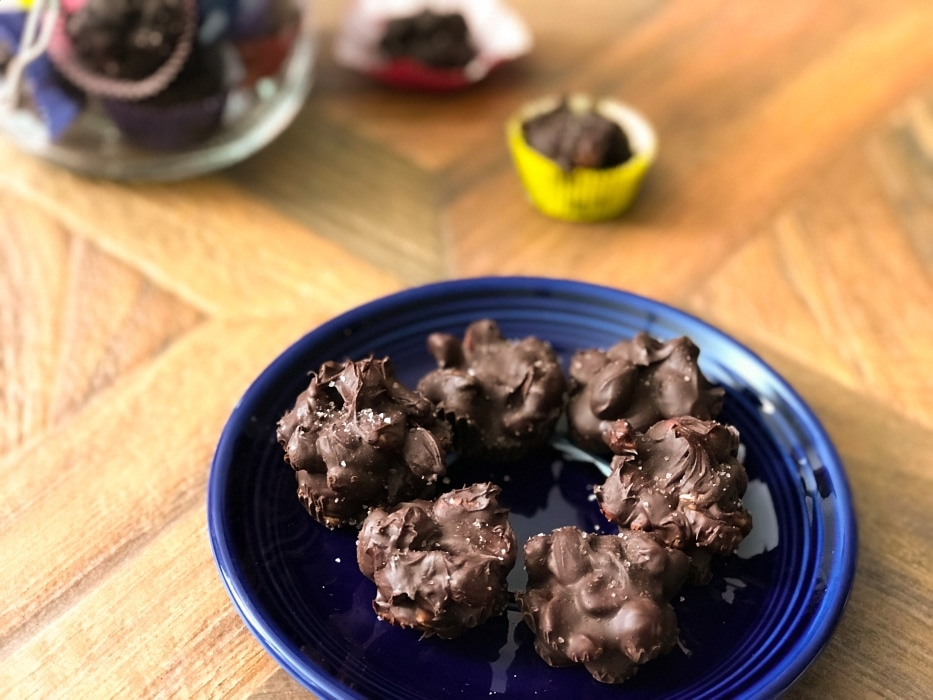 view of chocolate covered peanut clusters on a plate