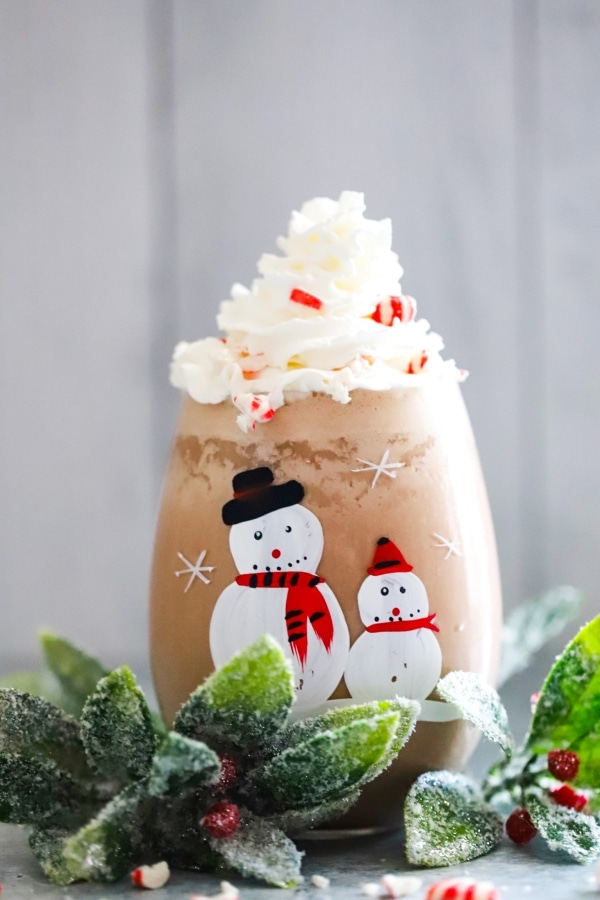 decorative snowman glass willed with peppermint chocolate shake