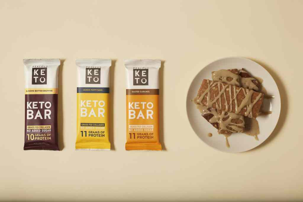 three keto bar flavors with a plate of unwrapped keto bars next to them