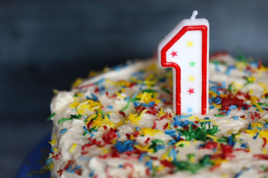 close up of cake with a number one candle