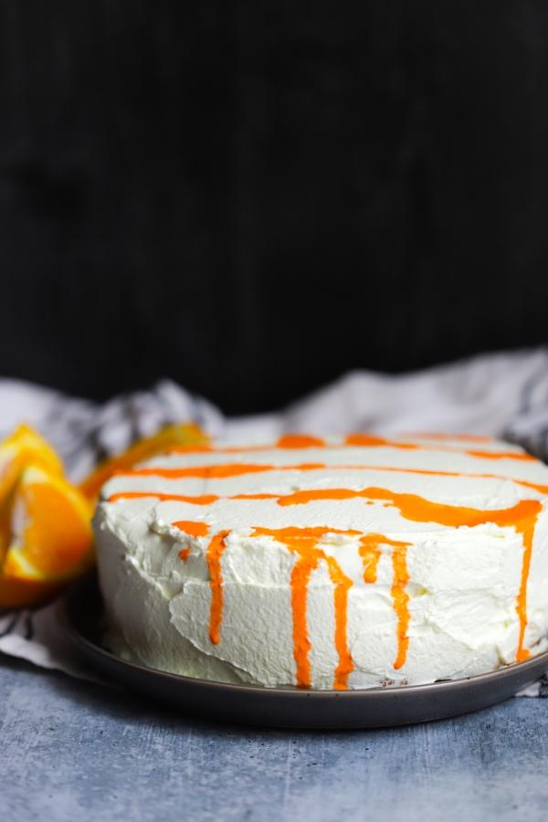 photo of the an unsliced orange creamsicle cake