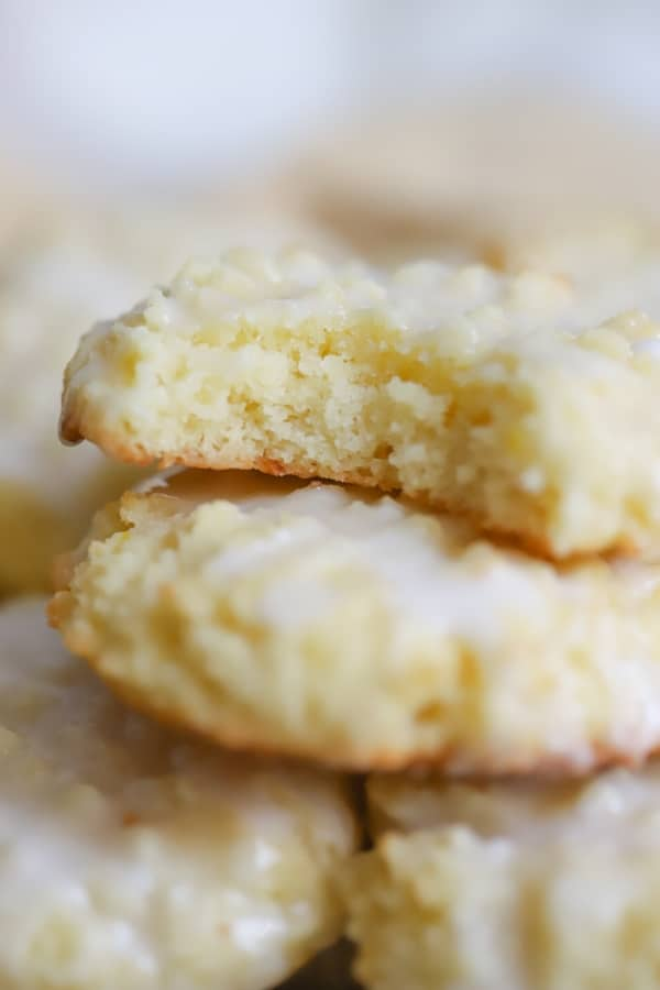 closeup of lemon cookies without on top of others and a bite taken out of it