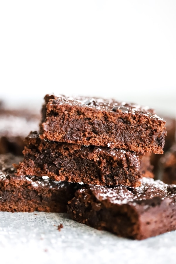 short stack of brownies between two brownies on the bottom