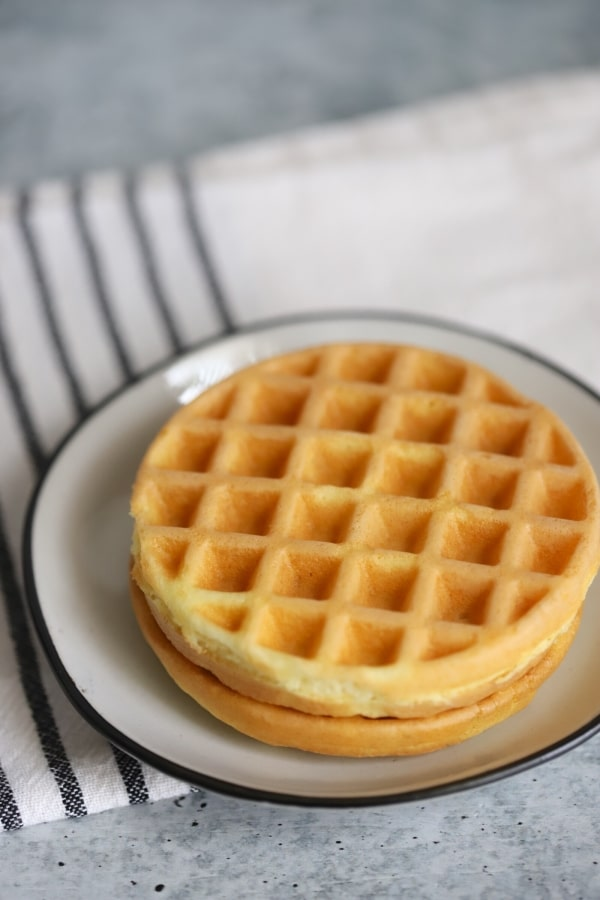 two plain white bread chaffles on a plate