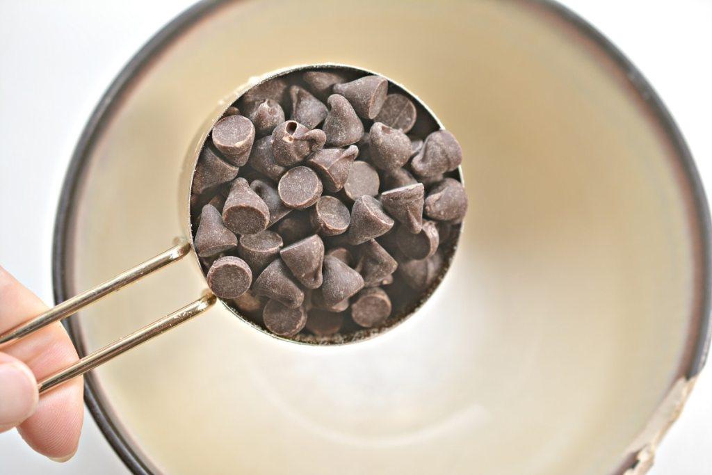 adding chocolate chips in a microwave safe bowl