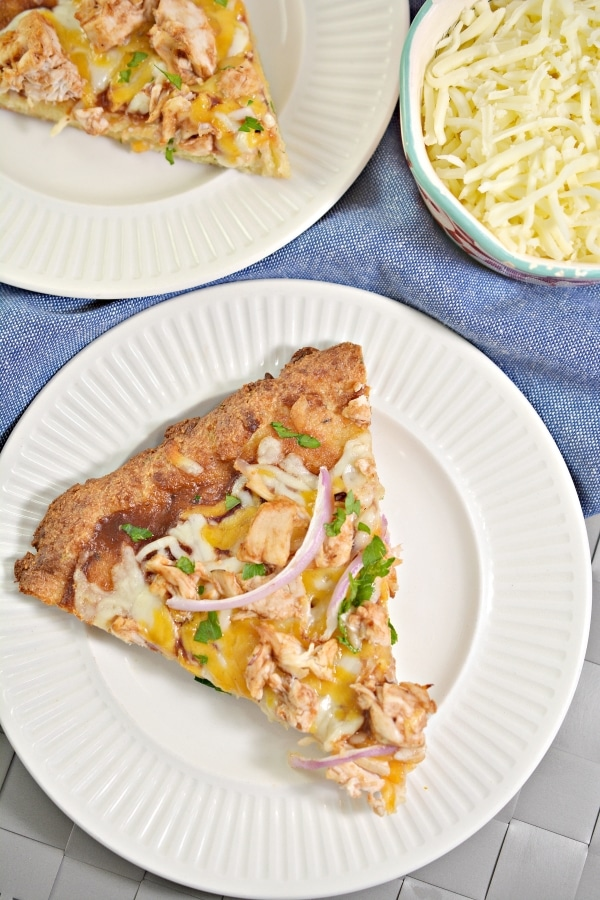 This Keto BBQ Chicken Pizza packs a whole lot of flavor and will become your new favorite! #ketobbqchickenpizza #ketopizza #lowcarbpizza #fatheaddough #easyketorecipes | buttertogetherkitchen.com