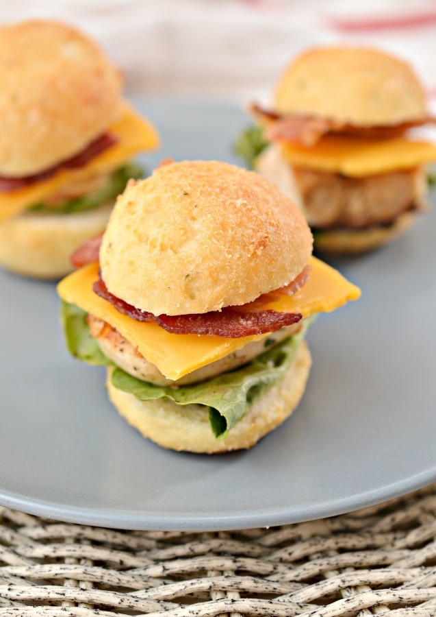 three chicken sliders on a plate