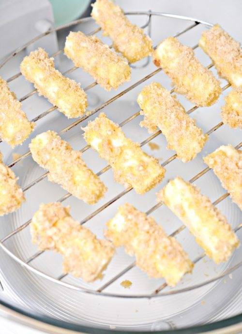 cheese sticks on metal sheet ready for air fryer