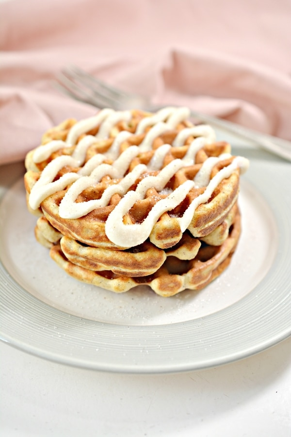 three cinnamon roll chaffles stacked up together on a plate