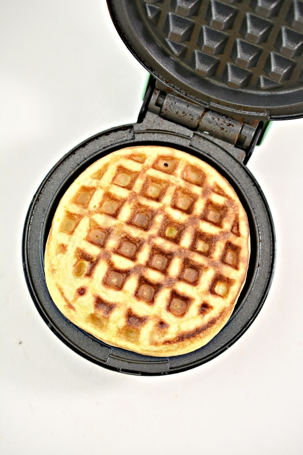 cooked lemon cake chaffle in a mini waffle maker