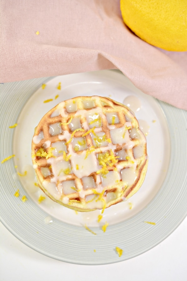 top view of stacked lemon cake chaffles on a plate