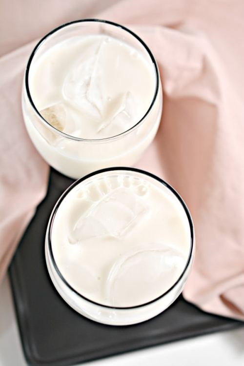 top view of two glasses of almond milk with ice