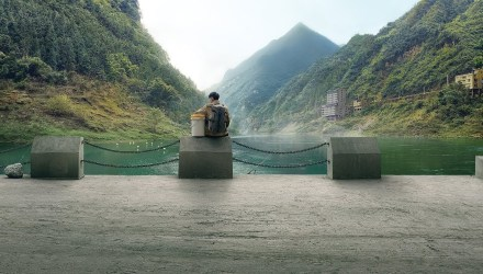 Image showing a person sitting with a bucket in China