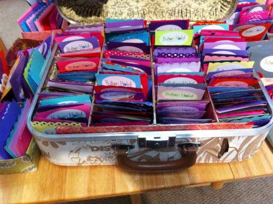 A vintage suitcase full of vintage Buttonhole! Buttons