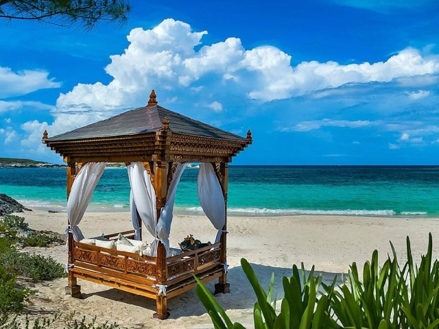 for-ultimate-relaxation-take-a-snooze-in-a-beach-side-day-bed-or-soak-in-one-of-the-four-hot-tubs